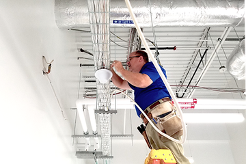 RSRF Engineer Installing DAS Antenna